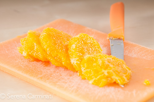 Step 2. Peel and cut the oranges .