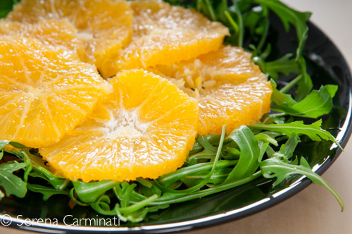 Steamed salmon with rocket and oranges (front view, rocket or arugula with oranges)