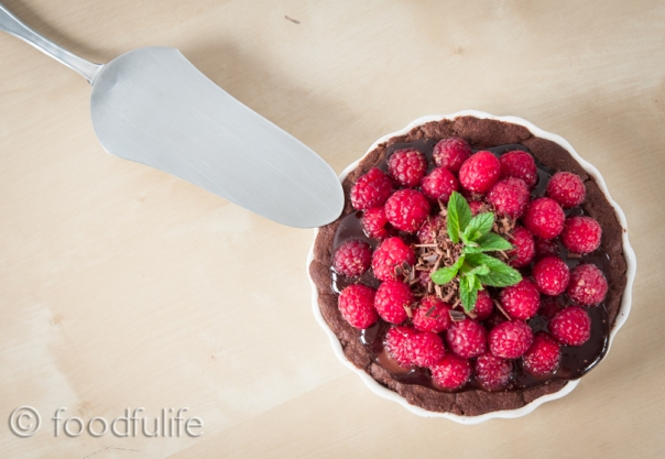 Rich chocolate tart with fresh raspberries.