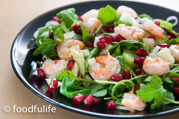Quick and easy prawn salad with rocket (arugula) leaves and pomegranate seeds.