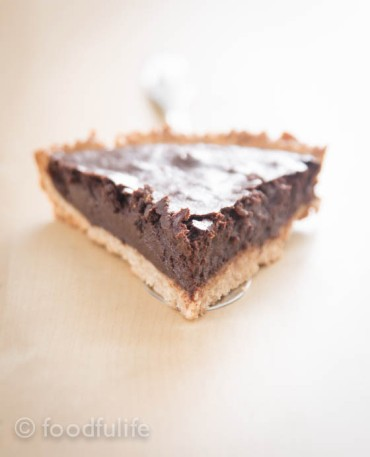 Slice Of Dark Chocolate And Marrons Glacés Tart