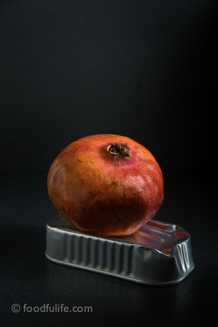 Pomegranate on tin can