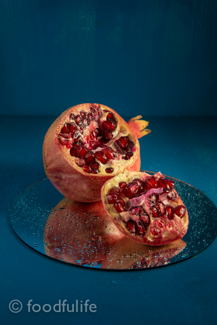 Pomegranate on round mirror