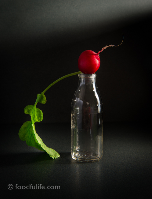 Radish on glass bottle