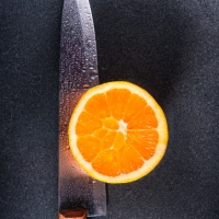 Orange With Kitchen Knife