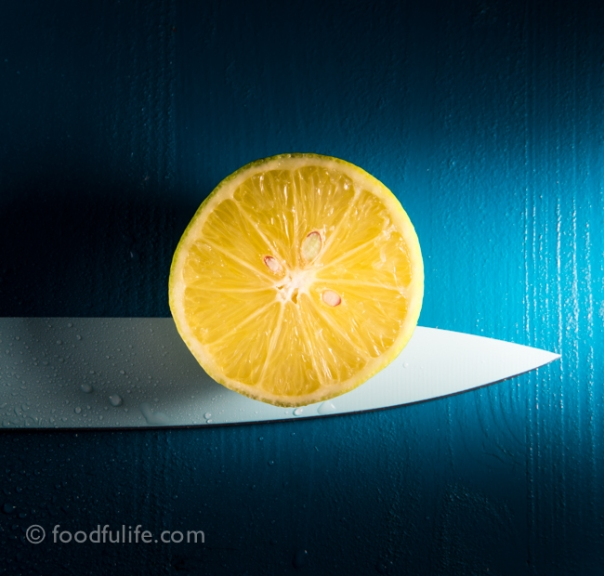 Half a lemon with knife