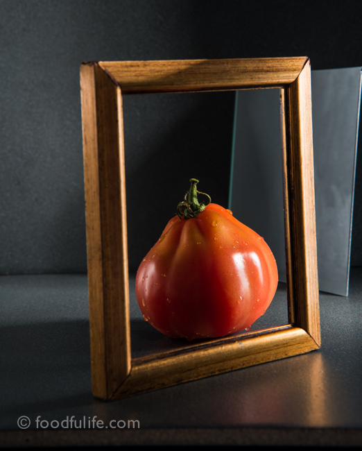 Tomato with picture frame and mirror