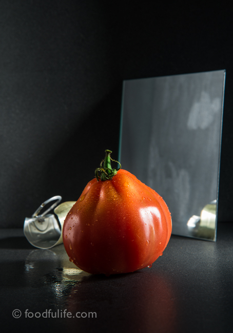Tomato with mirror and can lid