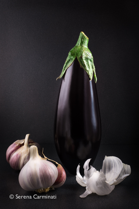 Aubergine with garlic and dark background